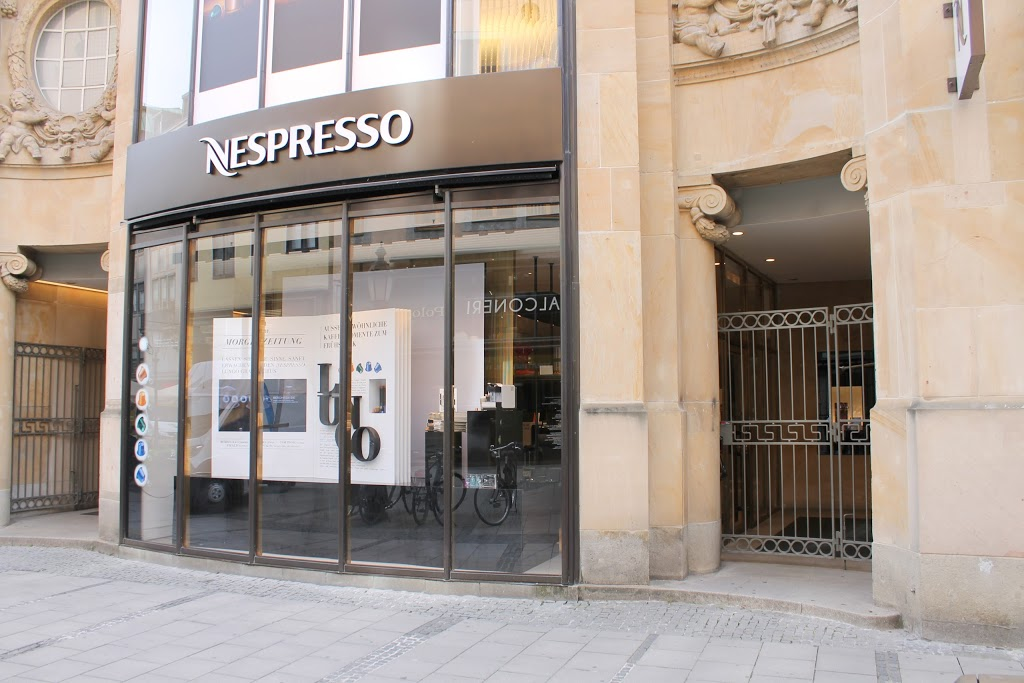 nespresso boutique munich esa engineering. Black Bedroom Furniture Sets. Home Design Ideas